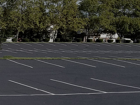 large parking lot with freshly painted lines